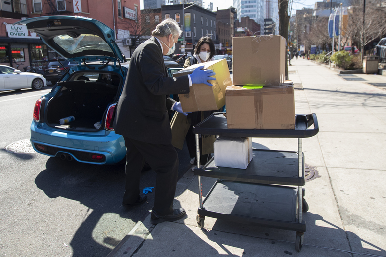 Lizzy Freedman delivers masks, gloves, and other protective gear Hauser and Wirth Gallery is donating to the Brooklyn Hospital Center, Thursday, March 26, 2020, in New York. The new coronavirus causes mild or moderate symptoms for most people, but for some, especially older adults and people with existing health problems, it can cause more severe illness or death. (AP Photo/Mary Altaffer)