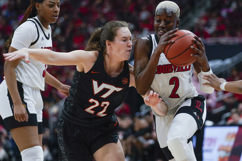Louisville guard Yacine Diop (2) drives against Virginia Tech guard Cayla King (22) during the first half of a women's NCAA college basketball game, Sunday, March 1, 2020, at the KFC YUM Center in Louisville, Ky. (AP Photo/Bryan Woolston)