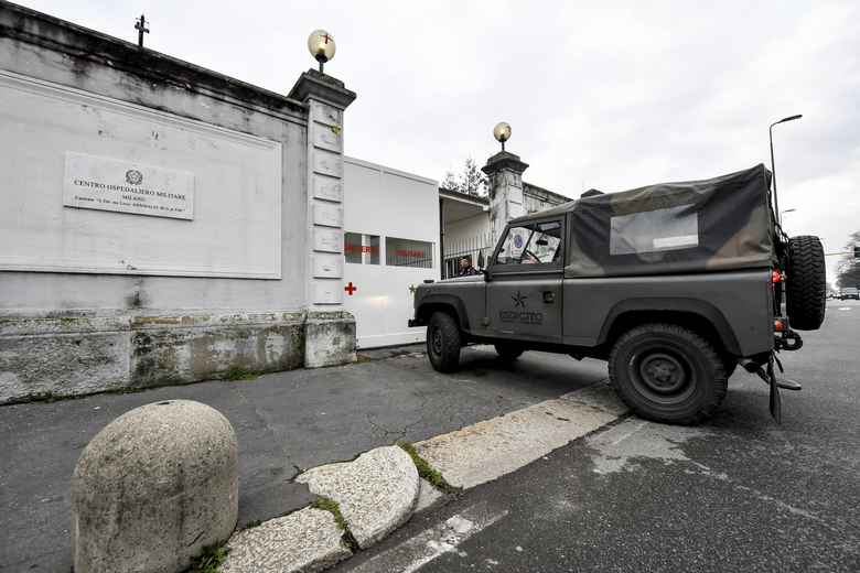 An army car enters former military hospital Baggio, which reopened a ward to hospitalize patients recovering from the COVID-19 virus, in Milan, Italy, Tuesday, March 2, 2020. The strain on Lombardy's health system has forced authorities to seek to bring doctors out of retirement, accelerate graduation dates for nursing students, and incorporate doctors and hospital beds from the private sector to ease the strain on public hospitals. (Claudio Furlan/LaPresse via AP)
