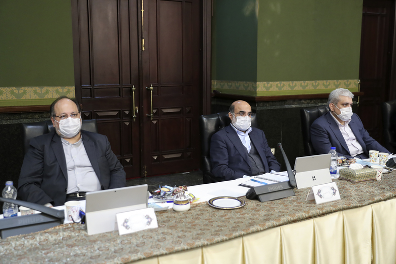 In this photo released by the official website of the office of the Iranian Presidency, cabinet members wearing face masks attend their meeting in Tehran, Iran, Wednesday, March 11, 2020. Senior Vice-President Eshaq Jahangiri and two other Cabinet members have contracted the new coronavirus, semiofficial Fars News Agency reported Wednesday. The vast majority of people recover from the new virus. (Iranian Presidency Office via AP)