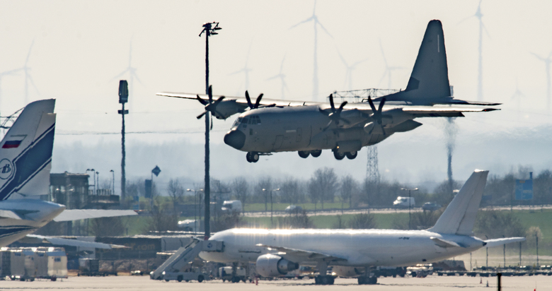 FILE – In this March 25, 2020, file photo, an Italian Air Force plane carrying two patients from Italy believed to have COVID-19, lands at Leipzig Airport, Germany. In the rare position of having beds to spare, German hospitals have taken in dozens of patients from Italy and France. (Hendrik Schmidt/dpa via AP, File)
