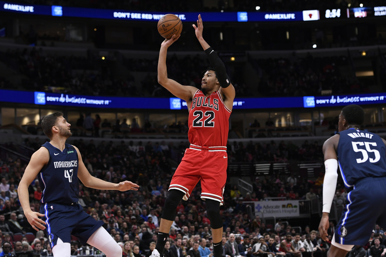 Chicago Bulls' Otto Porter Jr. (22) goes up to shoot against Dallas Mavericks' Maxi Kleber (42), of Germany, and Delon Wright (55) during the second half of an NBA basketball game Monday, March 2, 2020, in Chicago. (AP Photo/Paul Beaty)