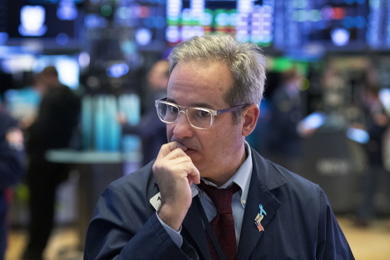 A trader works the floor at the New York Stock Exchange, Tuesday, March 17, 2020 in New York. (AP Photo/Mark Lennihan)
