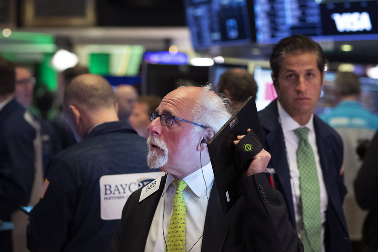 Stock trader Peter Tuchmann works at the New York Stock Exchange, Tuesday, March 17, 2020 in New York. (AP Photo/Mark Lennihan)