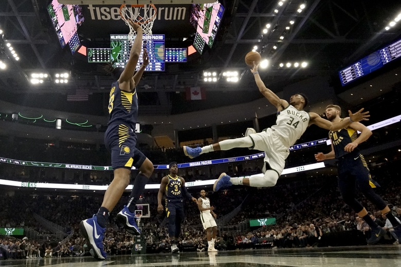 Milwaukee Bucks' Giannis Antetokounmpo shoots after being fouled during the second half of an NBA basketball game against the Indiana Pacers Wednesday, March 4, 2020, in Milwaukee. The Bucks won 119-100. (AP Photo/Morry Gash)
