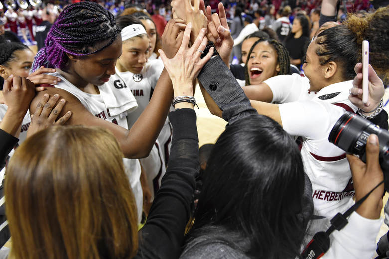 South Carolina's players gather after defeating Arkansas 90-64 during a semifinal match at the Southeastern Conference women's NCAA college basketball tournament in Greenville, S.C., Saturday, March 7, 2020. (AP Photo/Richard Shiro)