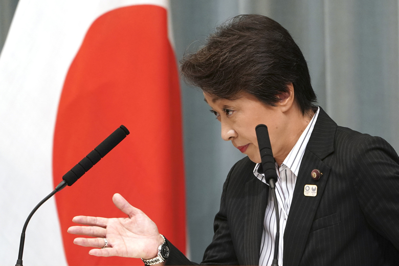 "FILE – In this Sept. 11, 2019, file photo, then newly appointed Minister in charge of the Tokyo Olympic and Paralympic Games Seiko Hashimoto speaks during a press conference at the prime minister's official residence in Tokyo. U.S. President Donald Trump's suggestion to postpone the Tokyo Olympics for a year because of the spreading coronavirus was immediately shot down by the Olympic minister. ""The IOC and the organizing committee are not considering cancellation or a postponement – absolutely not at all,"" Hashimoto, an Olympic bronze medalist, told a news conference on Friday, March 13, 2020 in Tokyo. (AP Photo/Eugene Hoshiko, File)"