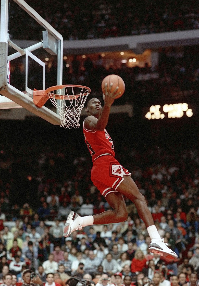 FILE – In this Feb. 6, 1988, file photo, Chicago Bulls' Michael Jordan dunks during the slam-dunk competition of the NBA All-Star weekend in Chicago.  Jordan left the old Chicago Stadium that night with the trophy. To this day, many believe Wilkins was the rightful winner.  (AP Photo/John Swart)