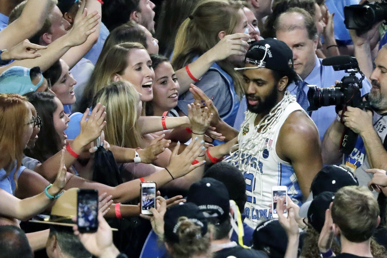 FILE – In this April 3, 2017, file photo, North Carolina guard Joel Berry II celebrates with fans after the championship game against Gonzaga at the Final Four NCAA college basketball tournament in Glendale, Ariz. North Carolina defeated Gonzaga 71-65. Berry was named MVP. (AP Photo/Matt York, File)