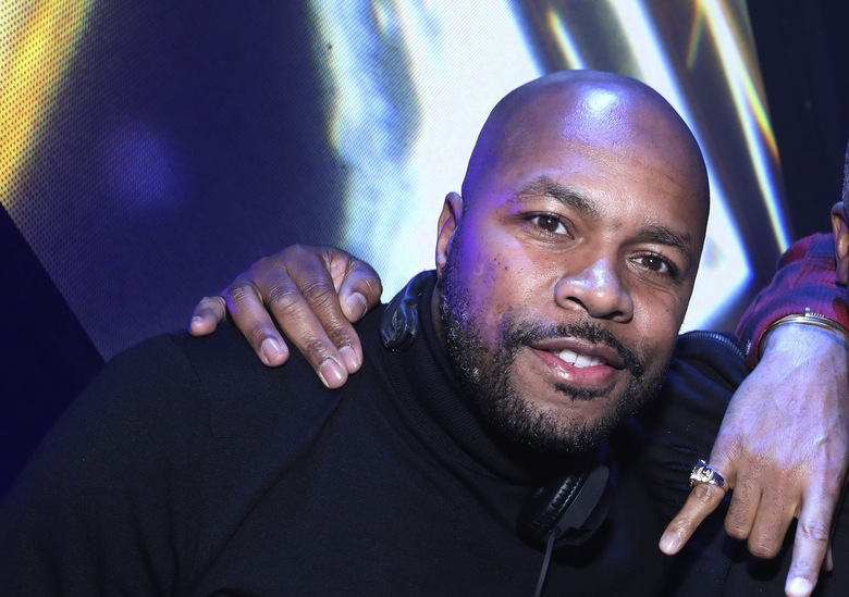 FILE – In this Sunday, Feb. 4, 2018, file photo, DJ D-Nice poses for a photo at The Player's Ball at The Armory in Minneapolis. The hottest social distancing party in town Saturday night, March 21, 2020, was on DJ D-Nice's Instagram, where more than 100,000 accounts tuned in during his 10-hour set, including the likes of Michelle Obama, Oprah, Rihanna and Will Smith. (Photo by Omar Vega/Invision/AP, File)