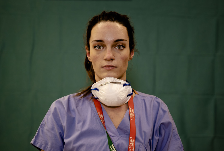Martina Papponetti, 25, a nurse at the Humanitas Gavazzeni Hospital in Bergamo, Italy poses for a portrait at the end of her shift, March 27, 2020. (AP Photo/Antonio Calanni)