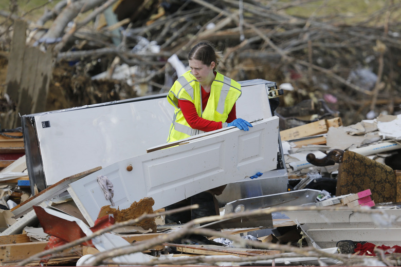 A worker searches for victims among the rubble in an area where several people were killed by storms Tuesday, March 3, 2020, near Cookeville, Tenn. Tornadoes ripped across Tennessee early Tuesday, shredding more than 140 buildings and burying people in piles of rubble and wrecked basements. At least 22 people were killed. (AP Photo/Mark Humphrey)