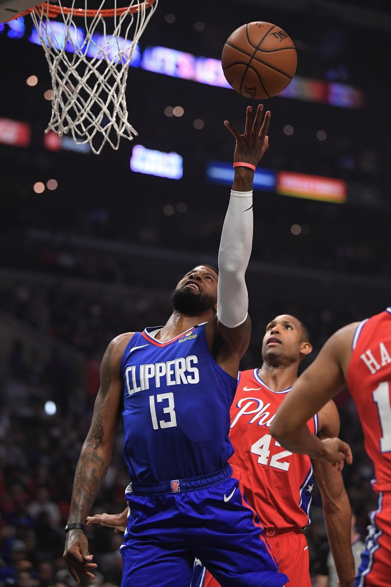 Los Angeles Clippers guard Paul George, left, shoots as Philadelphia 76ers forward Al Horford defends during the first half of an NBA basketball game Sunday, Mar. 1, 2020, in Los Angeles. (AP Photo/Mark J. Terrill)