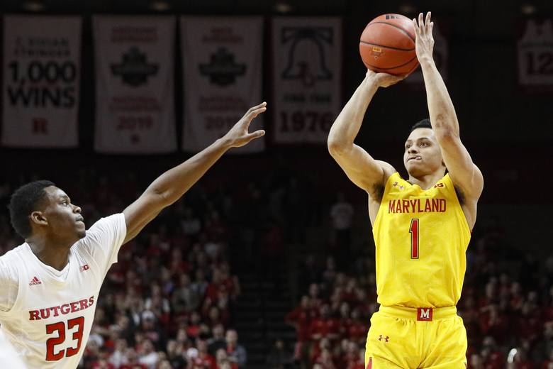Maryland's Anthony Cowan Jr. (1) shoots against Rutgers' Montez Mathis (23) during the first half of an NCAA college basketball game Tuesday, March 3, 2020, in Piscataway, N.J. (AP Photo/John Minchillo)