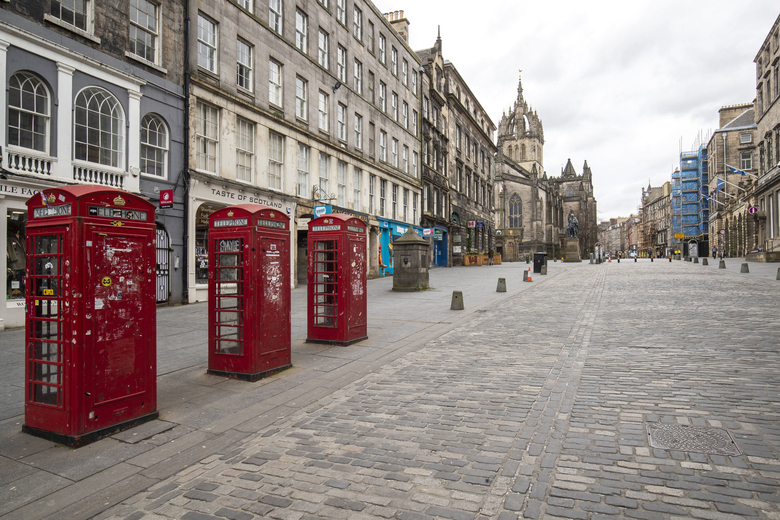 This photo shows the Royal Mile, part of the Old Town of Edinburgh, Scotland, Britain, Saturday, March 21, 2020, on the first day after Prime Minister Boris Johnson ordered pubs and restaurants across the country to close as the government announced measures to cover the wages of workers who would otherwise lose their jobs due to the coronavirus outbreak. (Jane Barlow/PA via AP)