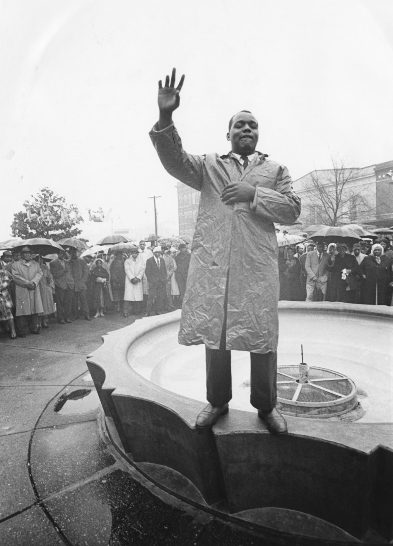 "FILE – In this Dec. 12, 1960 file photo, Lonnie King, leader, of the Atlanta Student Movement addresses demonstrators in Atlanta in a group prayer before a protest against retail shops. Following the publication of ""An Appeal for Human Rights"" on March 9, 1960, students at Atlanta's historically black colleges waged a nonviolent campaign of boycotts and sit-ins protesting segregation at restaurants, theaters, parks and government buildings. (AP Photo, File)"