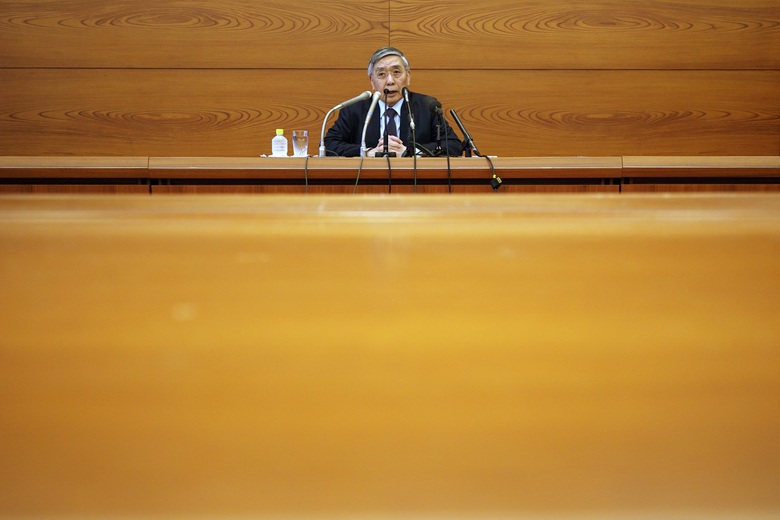 Bank of Japan Gov. Haruhiko Kuroda speaks during a news conference in Tokyo Monday, March 16, 2020. Japan's central bank took emergency action Monday to help support the economy following the U.S. Federal Reserve's decision to cut its benchmark interest rate to nearly 0%. (AP Photo/Eugene Hoshiko)