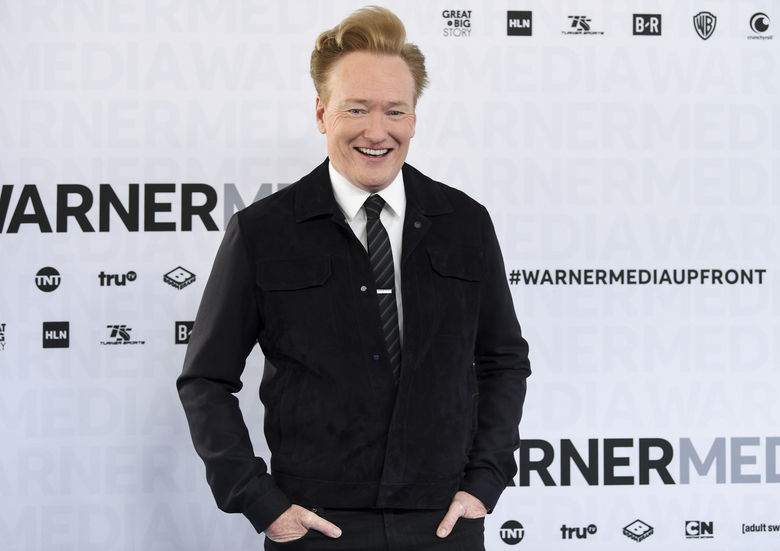 "FILE – In this May 15, 2019 file photo shows late night talk show host Conan O'Brien at the WarnerMedia Upfront in New York. O'Brien said he will resume putting out new episodes of TBS' ""Conan"" on March 30. His staff will remain at home, and the show will be cobbled together with O'Brien on an iPhone and guests via Skype.  (Photo by Evan Agostini/Invision/AP, File)"