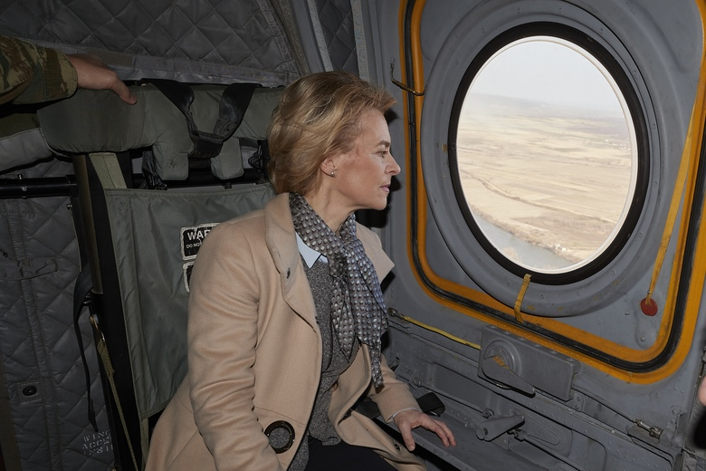 European Commission President Ursula von der Leyen looks out the window as she flies over the Greek-Turkish border on Tuesday, March 3, 2020. Migrants and refugees hoping to enter Greece from Turkey appeared to be fanning out across a broader swathe of the roughly 200-kilometer-long land border Tuesday, maintaining pressure on the frontier after Ankara declared its borders with the European Union open. (Dimitris Papamitsos/Greek Prime Minister's Office via AP)