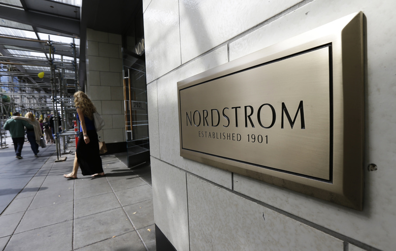 "Nordstrom's flagship store in downtown Seattle. The retailer plans to permanently close 16 of its 116 full-line stores and restructure its regional and corporate organization ""for greater speed and flexibility."" (Ted S. Warren / AP, file)"