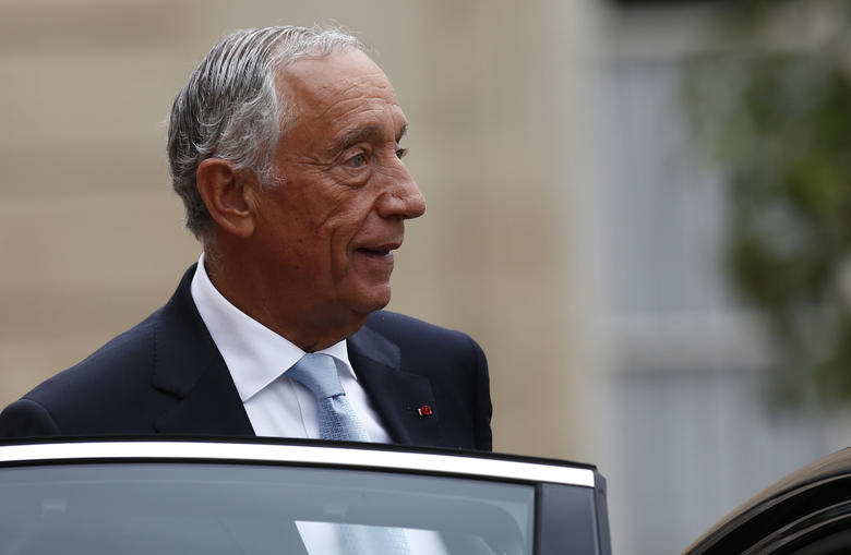FILE – In this Sunday, July 14, 2019 file photo, Portugal's President Marcelo Rebelo de Sousa leaves after a lunch at the Elysee Palace that followed Bastille Day parade on the Champs-Elysees avenue in Paris. The office of Portugal's 71-year-old president said Sunday March 8, 2020 that he has canceled all public activities and will stay at home amid the coronavirus outbreak. (AP Photo/Kamil Zihnioglu, File)