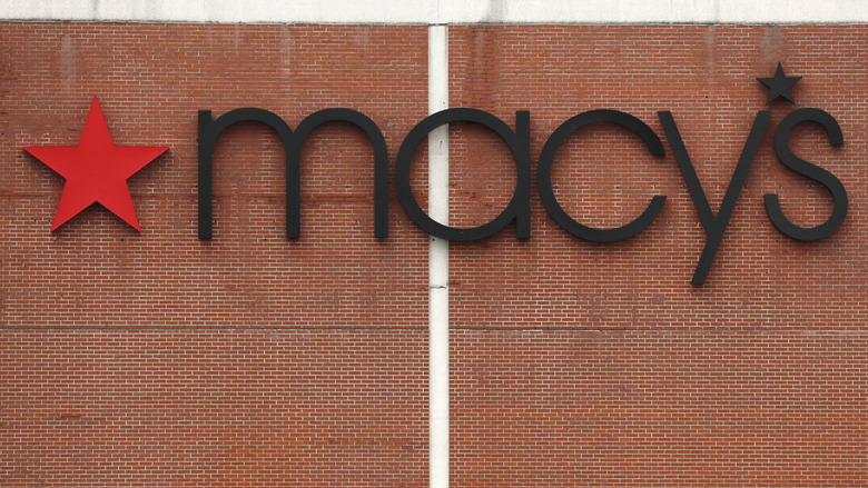 The Macy's store logo is displayed on their store in Burlington, Mass., Monday, March 30, 2020. Macy's announced that they would furlough a majority of their 130,000 workers after their stores closed due to the virus outbreak. (AP Photo/Charles Krupa)