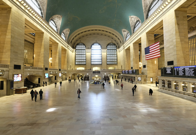 A sparsely occupied Grand Central Station appears at midday on March 18, 2020 in New York. (Photo by Evan Agostini/Invision/AP)
