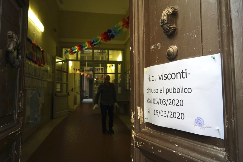 A note advising that the Ennio Quirino Visconti school will be closed through March 15 hangs from a door, in Rome, Thursday, March 5, 2020. Italy's virus outbreak has been concentrated in the northern region of Lombardy, but fears over how the virus is spreading inside and outside the country has prompted the government to close all schools and Universities nationwide for two weeks. (AP Photo/Andrew Medichini)