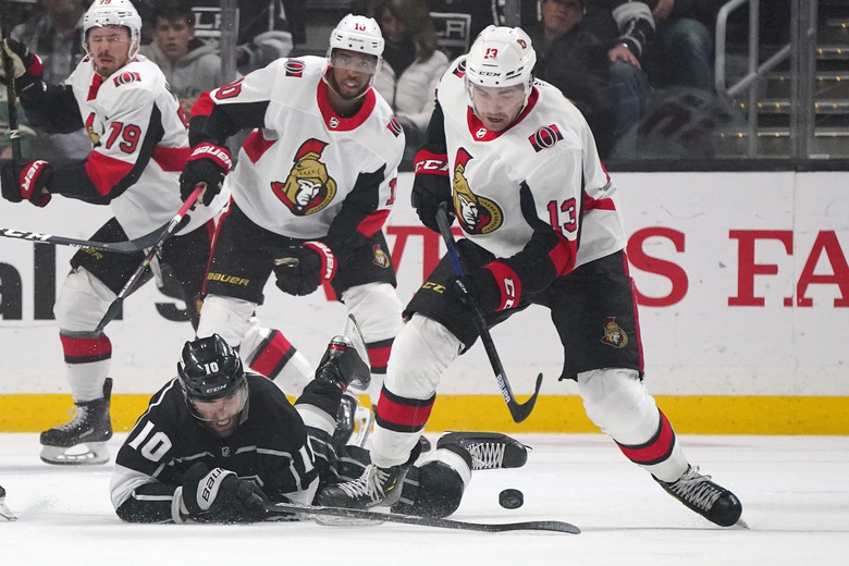 Los Angeles Kings center Michael Amadio, lower left, falls as Ottawa Senators left wing Nick Paul, right, takes the puck as right wing Jayce Hawryluk, left, and left wing Anthony Duclair watch during the second period of an NHL hockey game Wednesday, March 11, 2020, in Los Angeles. (AP Photo/Mark J. Terrill)
