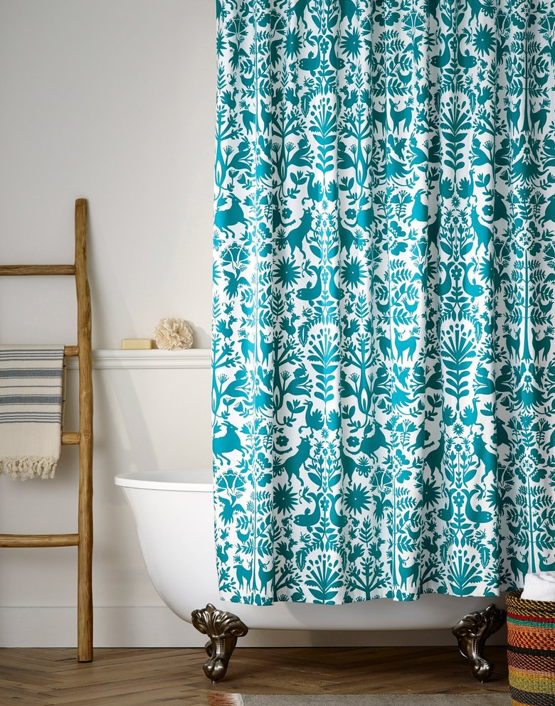 This photo provided by Hygge & West shows the Otomi Shower Curtain in Turquoise. Renters have traditionally been limited in how boldly they can decorate and still get their security deposit back. But new products are making renters' decorating dreams more doable. (Hygge & West via AP)
