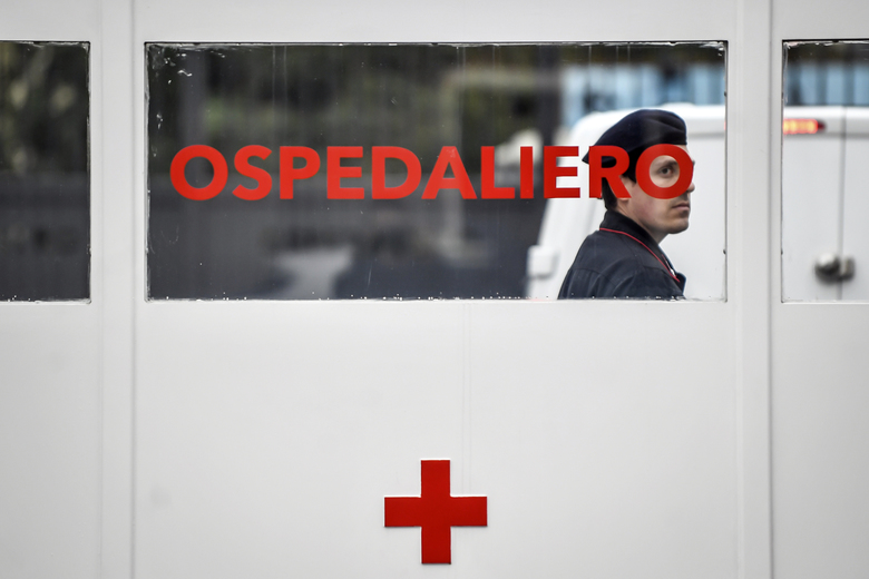 A Carabinieri (Italian paramilitary police) officer on patrol at former military hospital Baggio, which reopened a ward to hospitalize patients recovering from the COVID-19 virus, in Milan, Italy, Tuesday, March 2, 2020. The strain on Lombardy's health system has forced authorities to seek to bring doctors out of retirement, accelerate graduation dates for nursing students, and incorporate doctors and hospital beds from the private sector to ease the strain on public hospitals. (Claudio Furlan/LaPresse via AP)