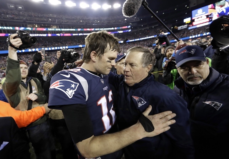 FILE – In this Jan. 21, 2018, file photo, New England Patriots quarterback Tom Brady, left, hugs coach Bill Belichick after the AFC championship NFL football game against the Jacksonville Jaguars, in Foxborough, Mass. Brady is an NFL free agent for the first time in his career. The 42-year-old quarterback with six Super Bowl rings said Tuesday morning, March 17, 2020, that he is leaving the New England Patriots. (AP Photo/David J. Phillip, File)