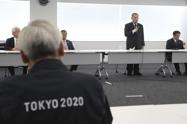 """Tokyo 2020 Organizing Committee President Yoshiro Mori, center at rear, speaks during the first meeting of the """"Tokyo 2020 New Launch Task Force"""" in Tokyo, Thursday, March 26, 2020, two days after the unprecedented postponement was announced due to the spreading coronavirus. The new Tokyo Olympics need dates for the opening and closing ceremony in 2021. Nothing moves until this is worked out by the International Olympic Committee, the Japanese government, and Tokyo organizers. (AP Photo/Koji Sasahara)"""