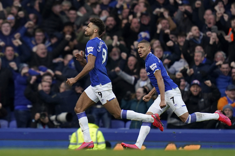 Everton's Dominic Calvert-Lewin runs celebrating after scoring a goal that was laster disallowed during the English Premier League soccer match between Everton and Manchester United at Goodison Park in Liverpool, England, Sunday, March 1, 2020. (AP Photo/Jon Super)