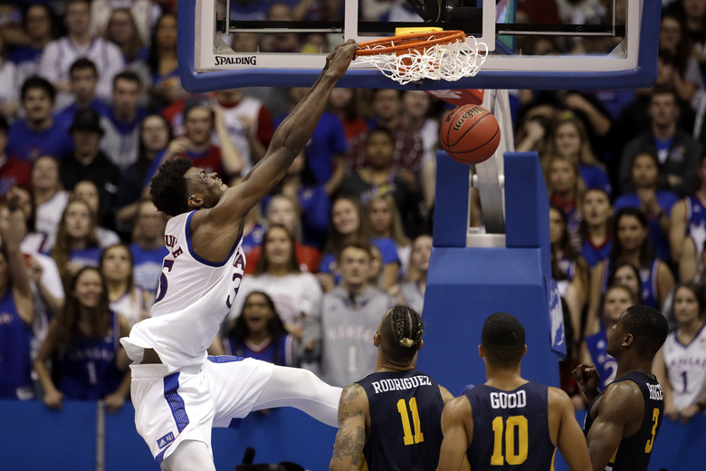 FILE – In this Nov. 19, 2019, file photo, Kansas center Udoka Azubuike (35) dunks the ball during the second half of an NCAA college basketball game against East Tennessee State in Lawrence, Kan. Azubuike was selected to the Associated Press All-Big 12 first team announced Tuesday, March 10, 2020. Azubuike was also named the AP Big 12 Player of the Year. (AP Photo/Charlie Riedel, File)