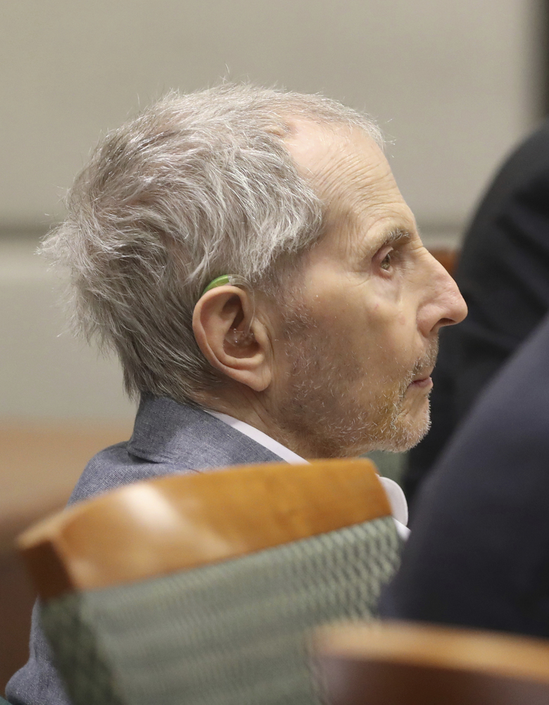 Robert Durst listens as opening statements in his murder trial continue Monday, March 9, 2020 in Los Angeles. (Lucy Nicholson/Pool Photo via AP)