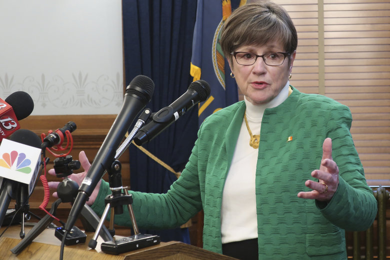 Kansas Gov. Laura Kelly answers questions from reporters after announcing that she'd order all public and private K-12 schools in the state to close for the rest of the semester, Tuesday, March 17, 2020, at the Statehouse in Topeka, Kan. Kelly issued the order in hopes of checking the spread of the coronavirus, and her action will move learning online for students. (AP Photo/John Hanna)