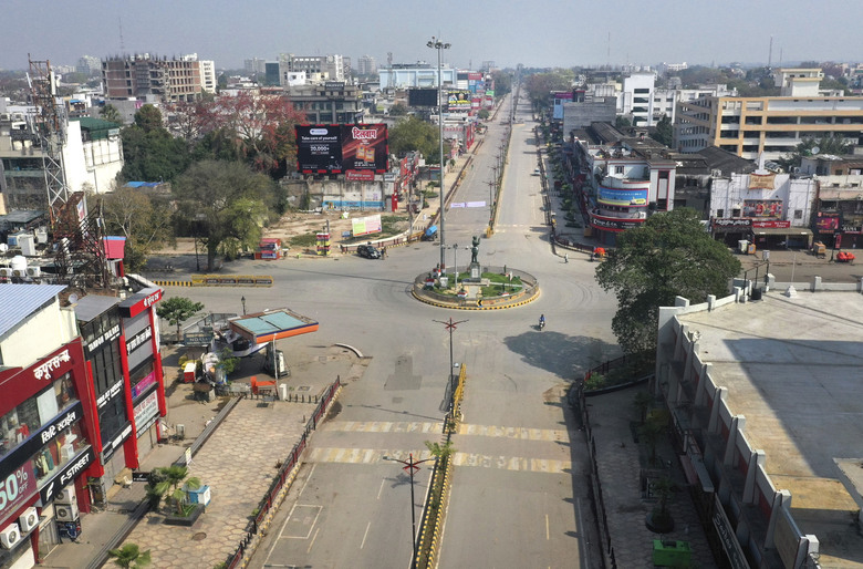 "A view of a deserted square in Prayagraj, India, Sunday, March 22, 2020. India is observing a 14-hour ""people's curfew"" called by Prime Minister Narendra Modi in order to stem the rising coronavirus caseload in the country of 1.3 billion. For most people, the new coronavirus causes only mild or moderate symptoms. For some it can cause more severe illness. (AP Photo/Rajesh Kumar Singh)"