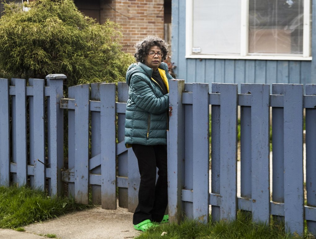 Ruby Holland outside her home in the Central District on Friday. Holland had received offers for her house many times before, but now she's worried as real estate investors are swooping in during hard times due to the pandemic. (Amanda Snyder / The Seattle Times)