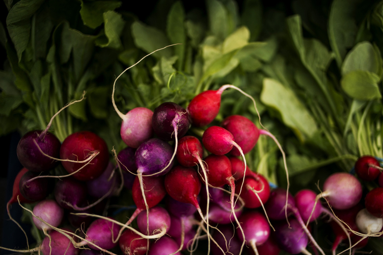 Organic Easter egg radishes are popular at farmers markets. (Bettina Hansen / The Seattle Times)