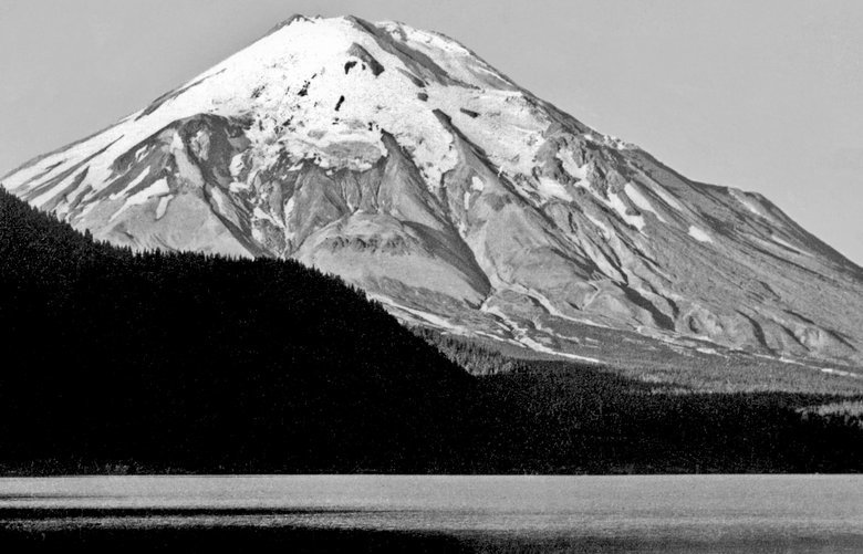 Mount St. Helens gleams in the mid-1940s in this image looking south from the shore of Spirit Lake. Credit: Boyd Ellis / Courtesy Paul Dorpat