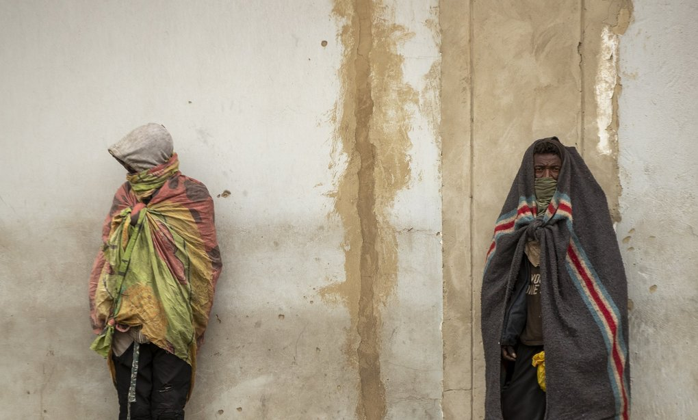In downtown Johannesburg, South Africa, homeless men stand against the wall on Tuesday, April 28, 2020. Many people have lost their income during South Africa's strict five-week lockdown in a effort to fight the coronavirus pandemic. (Themba Hadebe / The Associated Press)