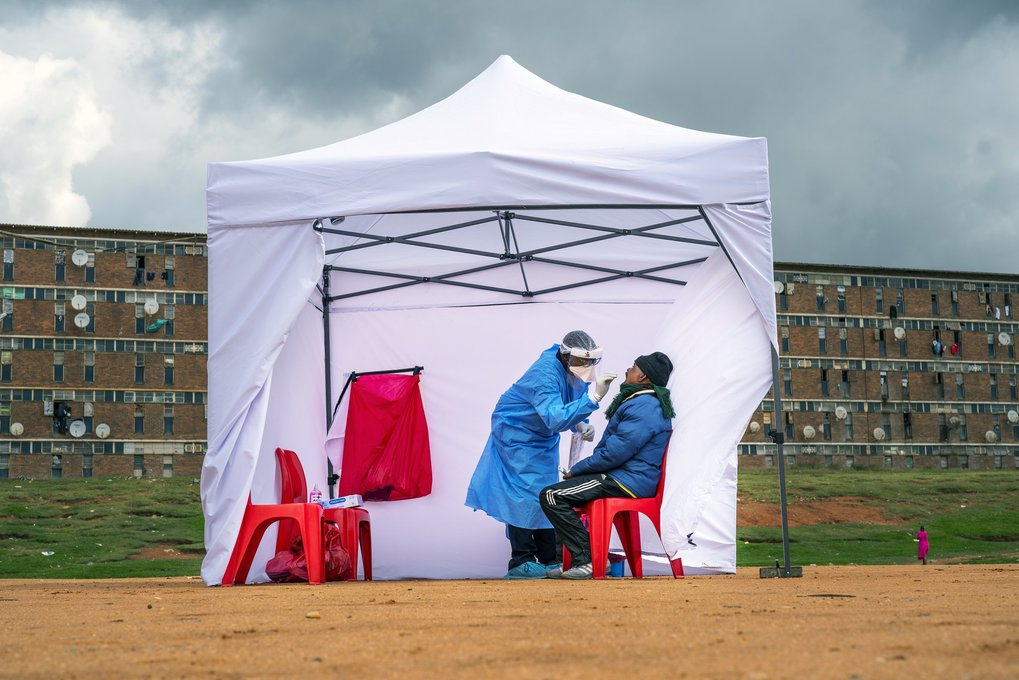 A resident from the Alexandra township is tested for COVID-19 in Johannesburg, South Africa on Wednesday. South Africa will begin a phased easing of its strict lockdown measures on May 1, although confirmed cases of coronavirus continue to increase. (Jerome Delay / The Associated Press)