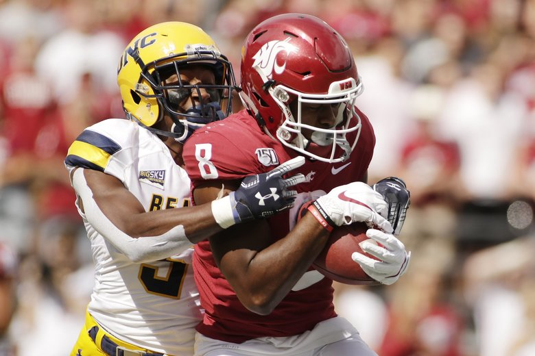 Washington State wide receiver Easop Winston Jr., right, catches a pass while defended by Northern Colorado cornerback Michael Walker during the first half of an NCAA college football game in Pullman, Wash., Saturday, Sept. 7, 2019. (AP Photo/Young Kwak) WAYK105 WAYK105 (Young Kwak / The Associated Press)