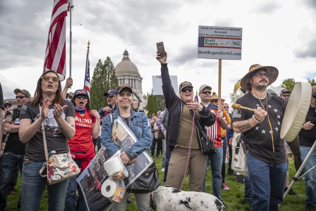 Conservative and libertarian groups gathered at the steps of the state Capitol in Olympia to protest Gov. Jay Inslee's stay-at-home order, and to demand a reopening of business and society. (Dean Rutz / The Seattle Times)