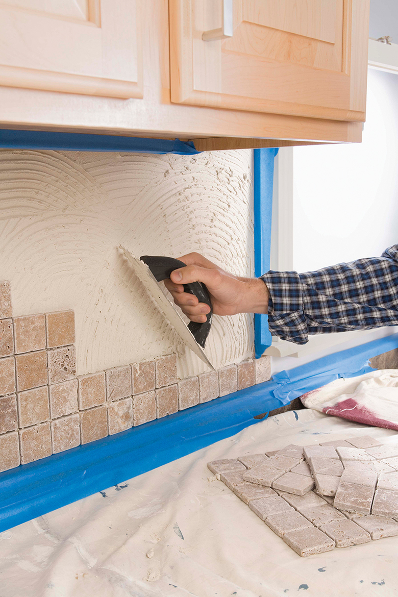 """Rich Melchior, owner of Kent-based Rich Design Group, encourages his clients to """"dare to dream"""" when remodeling their kitchens. That can include adding an elegant tile backsplash below the cabinets. (Getty Images)"""