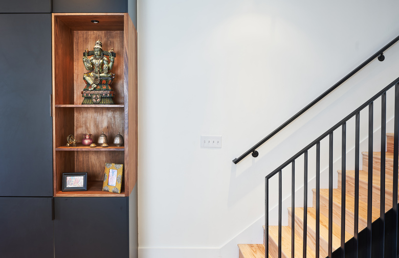 A shelf by the stairs holds a statue of an Indian god in the Harianis' home in Washington, D.C. (Photo for The Washington Post by Jeff Wolfram)