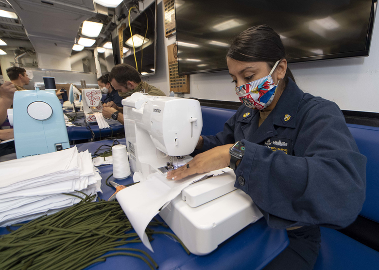 Navy Chief Personnel Specialist Erica Campos, on the USS Kidd, a guided-missile destroyer, makes cloth face masks for the crew on April 6. (U.S. Navy handout photo by Brandie Nuzzi).