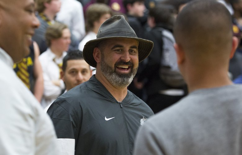 New Washington State University head football coach Nick Rolovich is pictured court side before a high school basketball game between O'Dea and Eastside Catholic Monday, Jan. 20, 2020 in Sammamish, Wash.