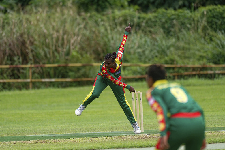 In this May, 2019, photo provided by the Vanuatu Cricket Association Selina Solman bowls during a women's cricket match in Port Vila, Vanuatu. The tropical island in the South Pacific is very likely to be the only venue in the world hosting a competitive cricket final on Saturday, as most international sport remains shuttered around the globe. (Ron Zwiers/Vanuatu Cricket Association via AP)